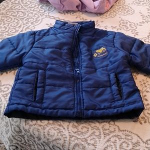 Blue puffer coat with truck detail